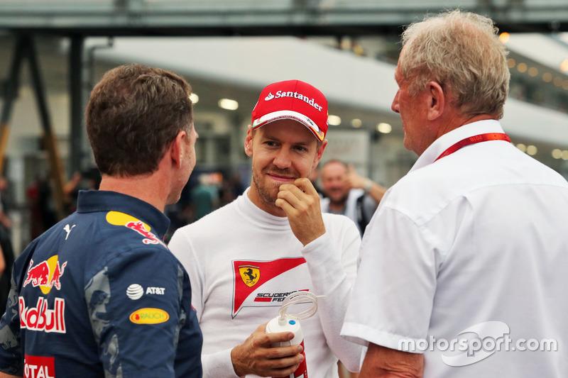 (L to R): Christian Horner, Red Bull Racing Team Principal with Sebastian Vettel, Ferrari and Dr Hel